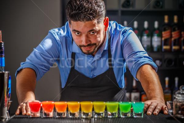 бармен радуга позируют коктейль создание вечеринка Сток-фото © grafvision