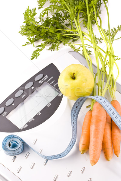 carrots, apple and measuring objects Stock photo © grafvision