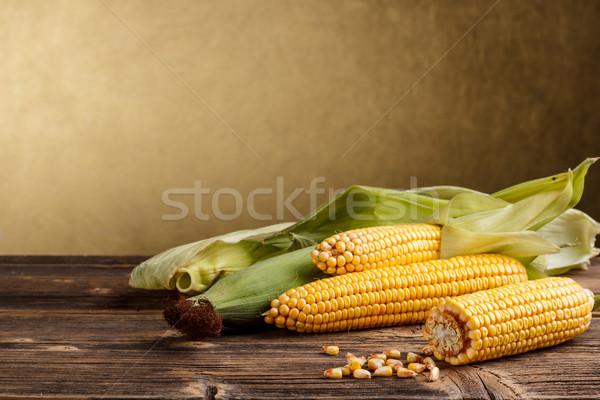 Foto stock: Milho · folhas · verdes · rústico · mesa · de · madeira · comida · fundo