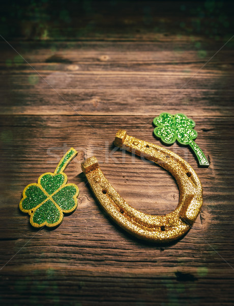 Golden Horseshoe with clover leaf Stock photo © grafvision