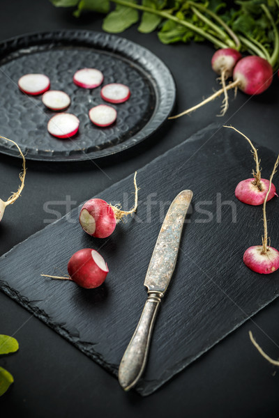 Sliced and whole fresh radishes Stock photo © grafvision