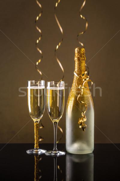ünnep pezsgő üveg kettő üveg boldog Stock fotó © grafvision