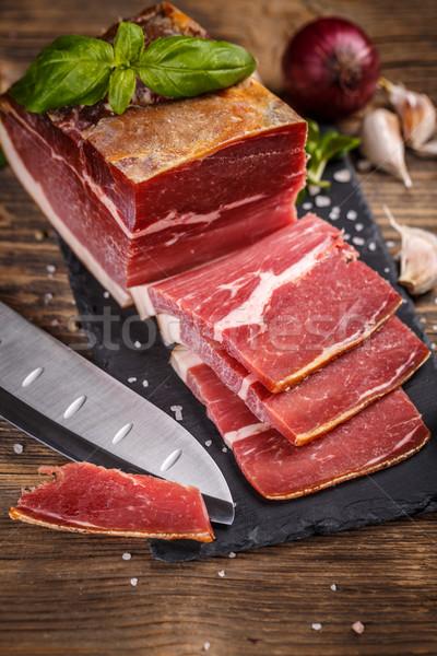 Prosciutto szeletel fekete rusztikus fából készült étel Stock fotó © grafvision