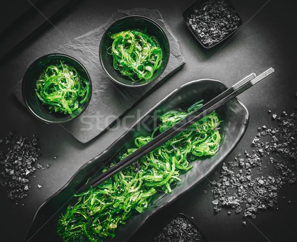 Egészséges hínár saláta salátástál fekete háttér Stock fotó © grafvision