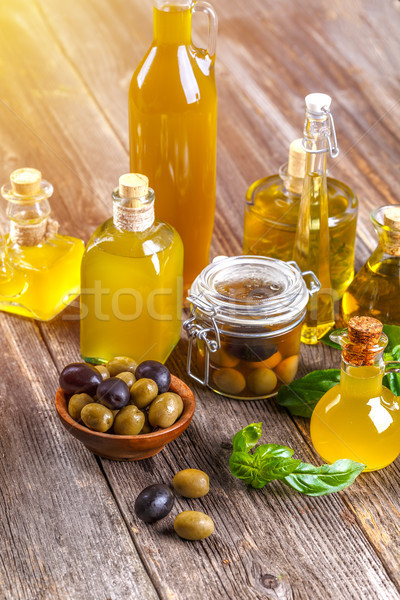 Olive oil and olive berries Stock photo © grafvision