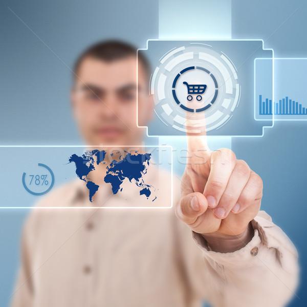 Bevásárlókocsi gomb üzletember kisajtolás futurisztikus digitális technológia Stock fotó © grafvision