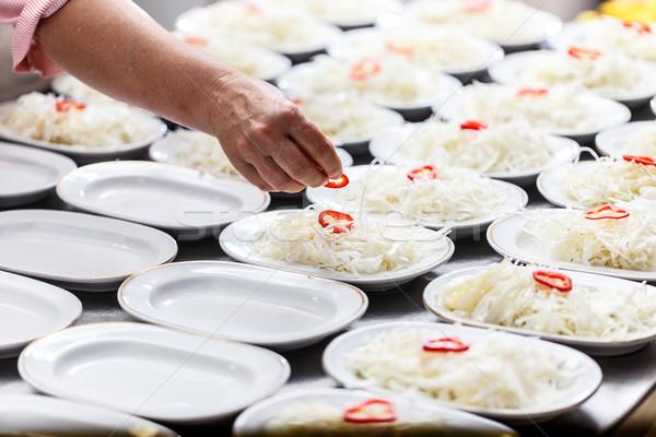 Cook is garnishing dish Stock photo © grafvision