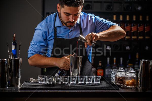Bartender with jigger Stock photo © grafvision
