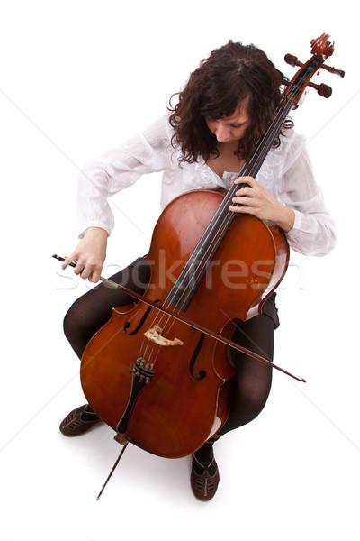 Młodych wiolonczelista gry wiolonczela biały twarz Zdjęcia stock © grafvision