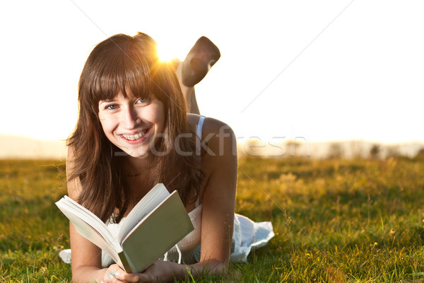 Girl reading a book outdoor Stock photo © grafvision
