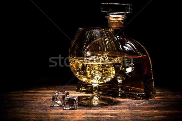 Cognac bouteille verre sombre fond bar Photo stock © grafvision