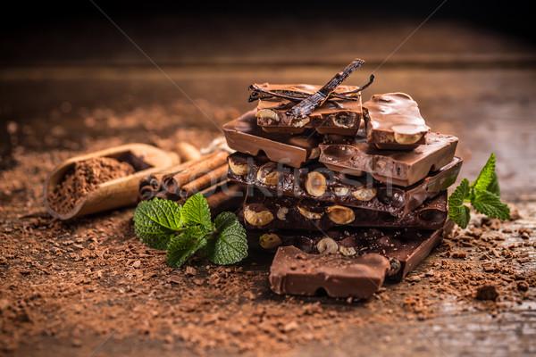 Törött csokoládé szelet fűszer fa asztal étel csokoládé Stock fotó © grafvision