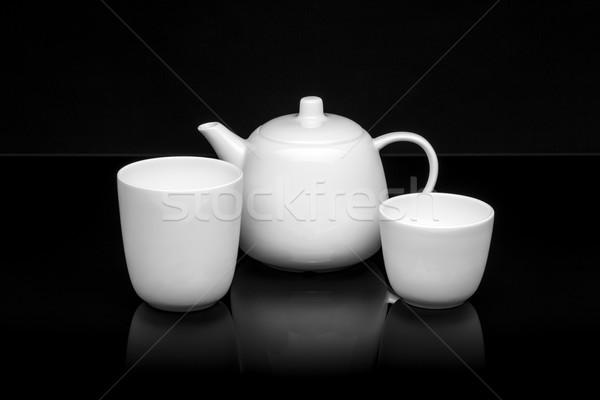 Fehér porcelán tea szett fekete csésze Stock fotó © grafvision