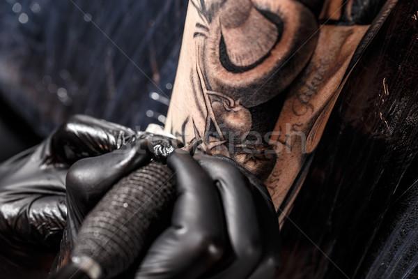 Közelkép tetoválás művész folyamat fekete festék Stock fotó © grafvision