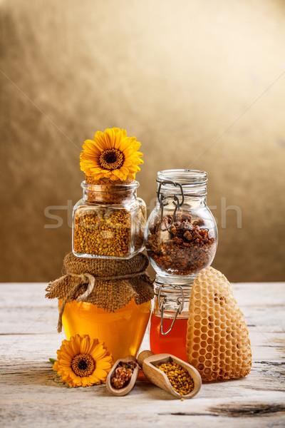 Miele a nido d'ape vetro jar polline propoli Foto d'archivio © grafvision
