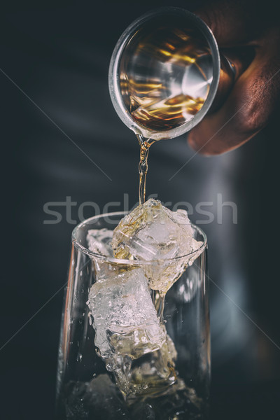 Bartender pouring alcohol Stock photo © grafvision