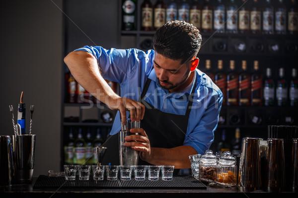 Bartender preparing an alcoholic beverage Stock photo © grafvision