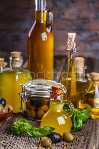 Olive oil with green and black olives  Stock photo © grafvision