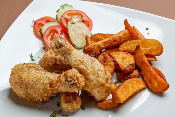 Roasted chicken drumsticks Stock photo © grafvision