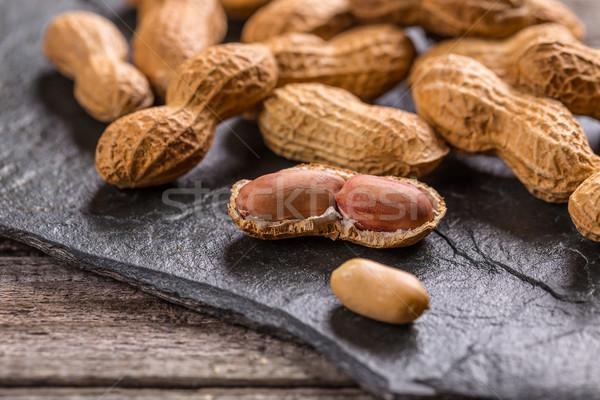 Amendoins conchas pedra tabela concha semente Foto stock © grafvision
