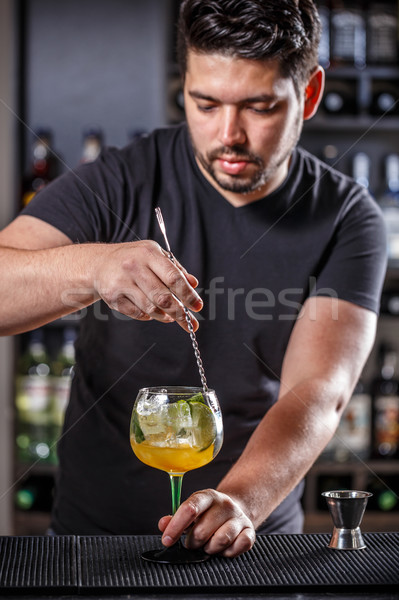 Bartender is stirring cocktail Stock photo © grafvision