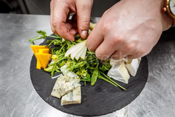 Chef garnishing cheese platter  Stock photo © grafvision