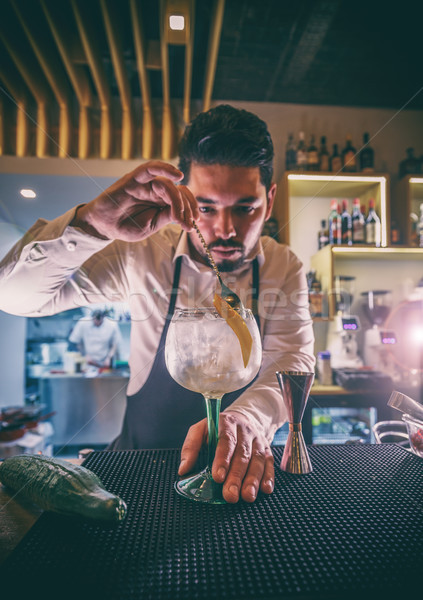 Bartender is stirring cocktails Stock photo © grafvision