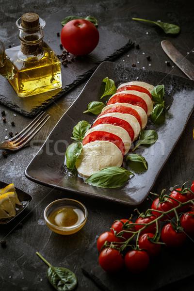 Vegetáriánus diéta olasz étel egészséges caprese saláta háttér Stock fotó © grafvision