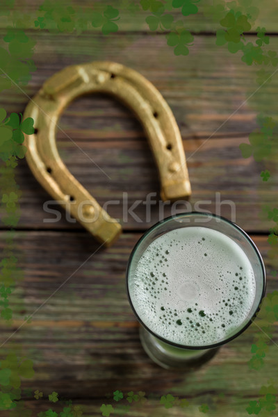 Glass of beer and horseshoe Stock photo © grafvision