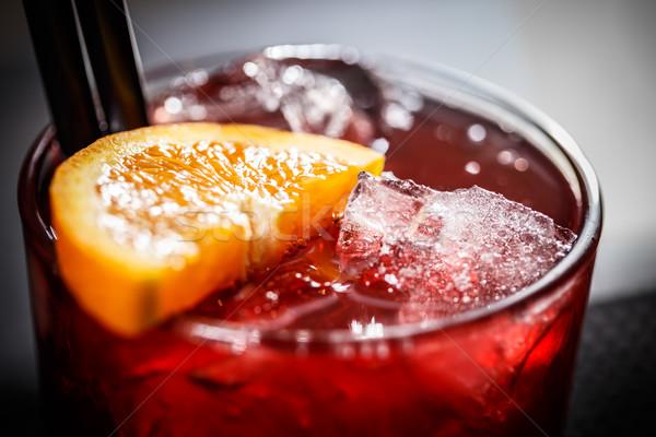 üveg piros koktél közelkép jégkocka narancsszelet Stock fotó © grafvision