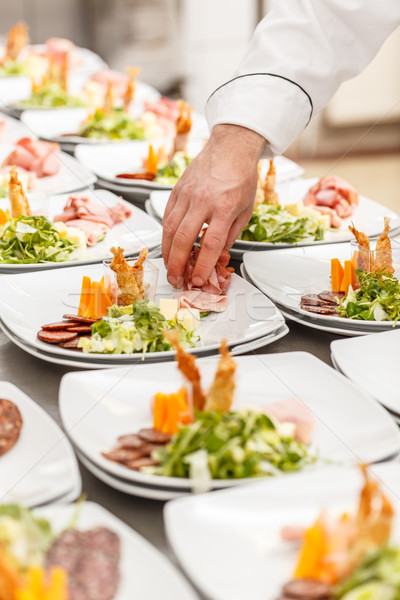 Chef is garnishing delicious appetizer dishes Stock photo © grafvision