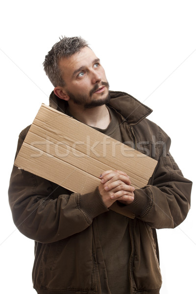 Beggar holding carton and pray Stock photo © grafvision