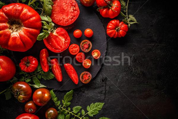 Posiekane pomidorów czarny kopia przestrzeń liści tle Zdjęcia stock © grafvision
