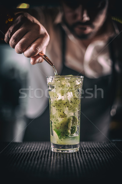 Man hands pouring alcoholic drink Stock photo © grafvision