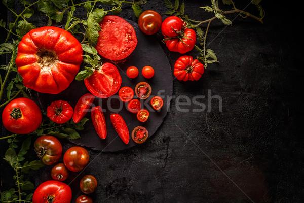 Frischen rot geschnitten ganze Tomaten schwarz Stock foto © grafvision