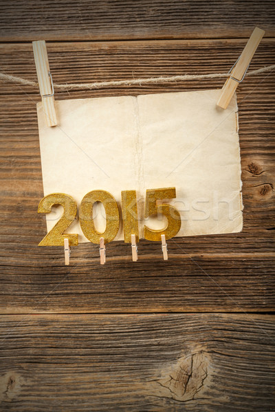 Paper and 2015 golden figures  Stock photo © grafvision