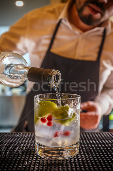 Bartender pouring vodka Stock photo © grafvision