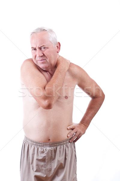 Férfi nyaki fájdalom idős izolált fehér kéz Stock fotó © grafvision