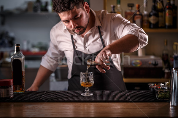 Bartender is pouring alcohol  Stock photo © grafvision