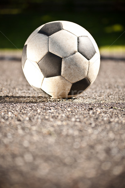 Soccer ball on asphalt Stock photo © grafvision