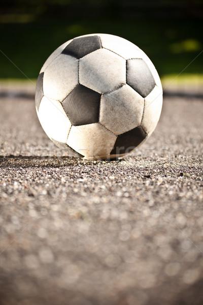 Сток-фото: футбольным · мячом · асфальт · используемый · спорт · футбола · лет
