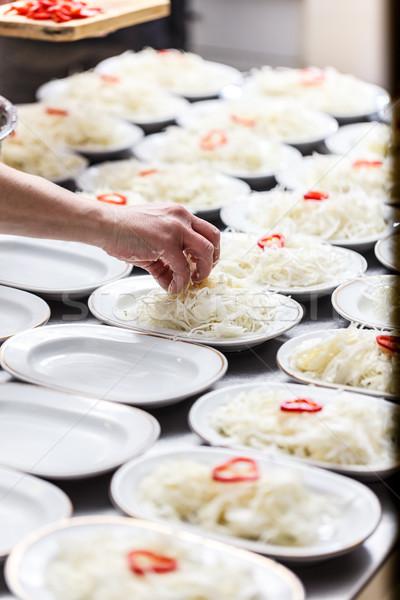 Aprított káposzta fehér tányérok étterem konyhapult Stock fotó © grafvision