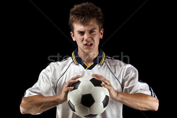 Zły piłka nożna piłkarz piłka twarz sportu Zdjęcia stock © grafvision