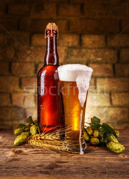 Naturaleza muerta cerveza pared de ladrillo verde beber botella Foto stock © grafvision