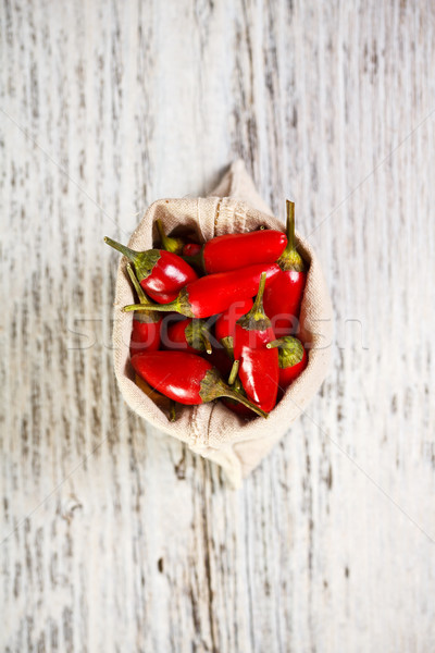 Vermelho pimentas saco pintado comida Foto stock © grafvision