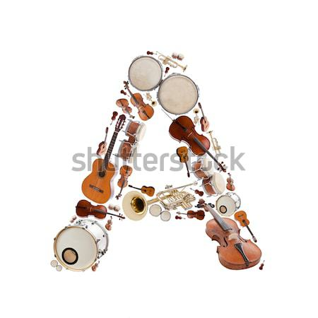 Muziekinstrumenten alfabet witte letter l boom gitaar Stockfoto © grafvision