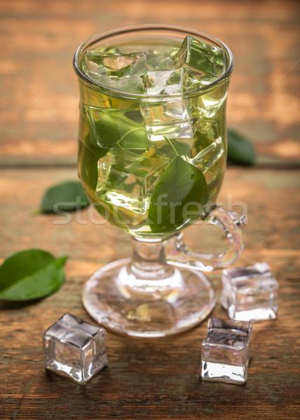 Jegestea csésze zöld tea levél üveg jég Stock fotó © grafvision