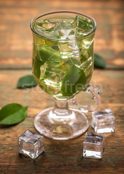 Chá gelado copo chá verde folha vidro gelo Foto stock © grafvision