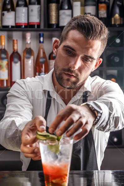 Bartender decorating cocktail  Stock photo © grafvision