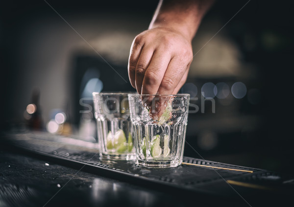 Barman hand squeezes lime juice Stock photo © grafvision